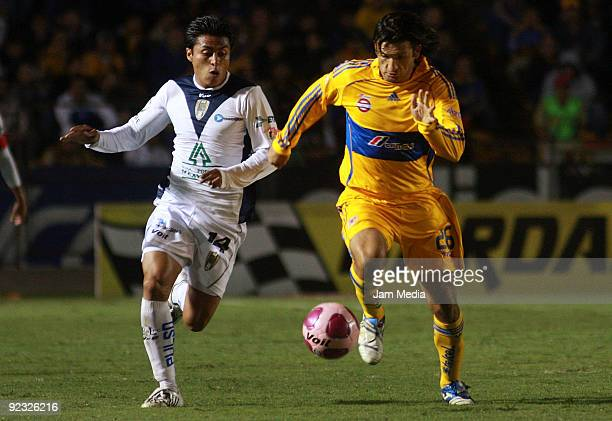 Noe Maya of San Luis vies for the ball with Francisco Fonseca of Tigres during their match in the 2009 Opening tournament the Mexican Football League...