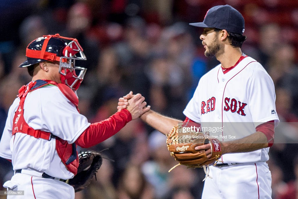 Noe Ramirez #66 and Christian Vazquez #7 of the Boston Red Sox shake hands after defeating the Tampa Bay Rays on April 20, 2016 at Fenway Park in Boston, Massachusetts .