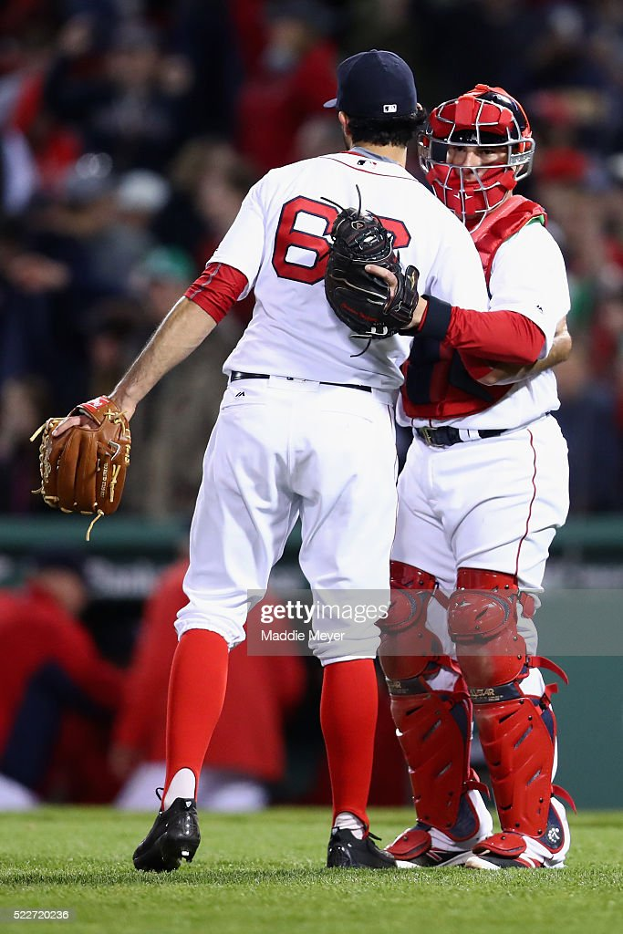 Noe Ramirez #66 of the Boston Red Sox and Christian Vazquez #7 celebrate after defeating the Tampa Bay Rays 7-3 at Fenway Park on April 20, 2016 in Boston, Massachusetts.