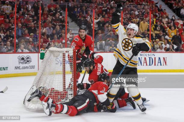 Noel Acciari of the Boston Bruins celebrates what he believes to be the overtime winning goal against Mark Stone Derick Brassard Craig Anderson and...