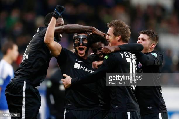 Noel Alexandre Mendy celebrates after scoring their first goal with Halil Savran during the Third Bundesliga match between Holstein Kiel and Hansa...