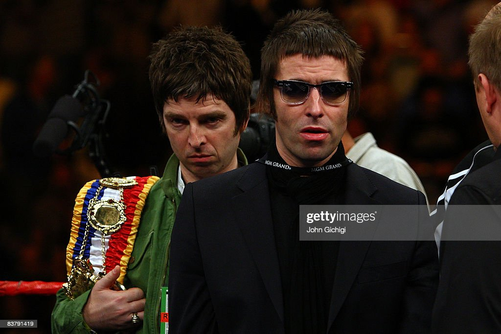 Noel and Liam Gallagher of Oasis bring out boxer Ricky Hatton of England's belts before taking on Paulie Malignaggi during their light-welterweight fight at the MGM Grand Garden Arena November 22, 2008 in Las Vegas, Nevada.