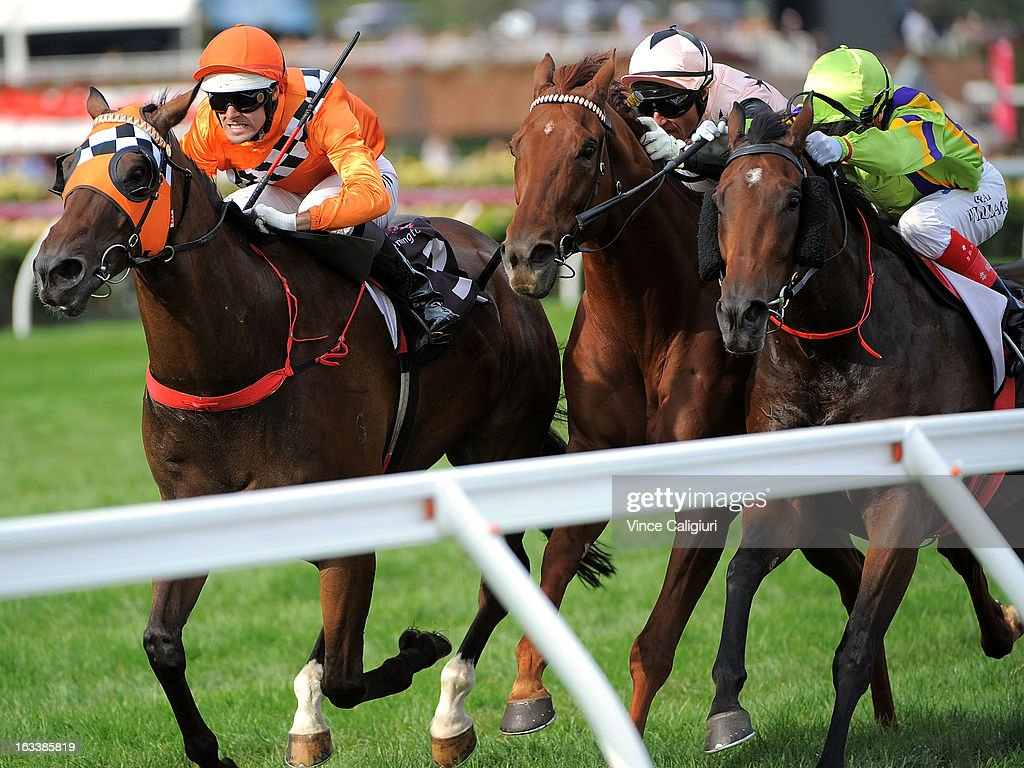 Noel Callow riding Centennial Park defeats Glen Boss riding British General and Craig Williams riding Star of Giselle in the Super Saturday Stakes during Super Saturday at Flemington Racecourse on March 9, 2013 in Melbourne, Australia.