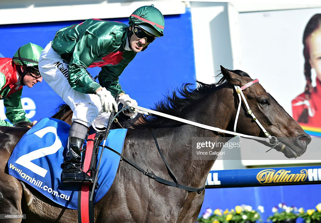 Noel Callow riding Sertorius defeats William Pike riding Escado in Race 7, the Le Pines Funerals Easter Cup during Melbourne racing at Caulfield Racecourse on April 4, 2015 in Melbourne, Australia.
