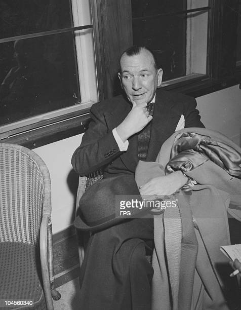 Noel Coward British playwright author and actor holding an overcoat and hat upon his arrival in New York City New York USA January 1949 Coward had...