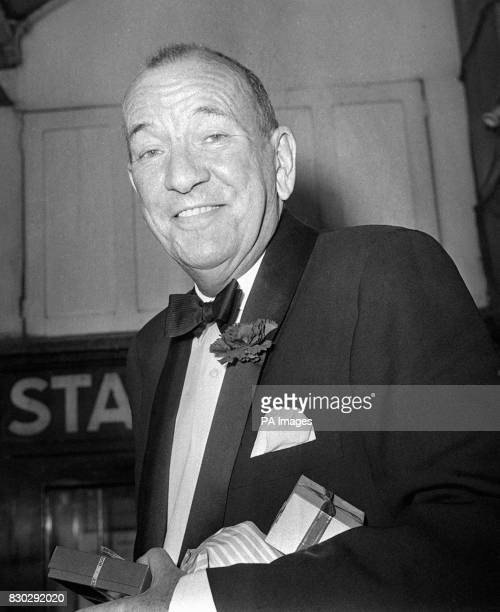 Noel Coward slips in the stage door for the opening of his new musical show 'Sail Away' at the Savoy Theatre in London