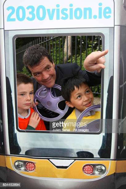 Noel Dempsey TD Minister for Transport launches the website www2030visionie in Merrion Square Dublin helped by school children Jake Ryan and John...