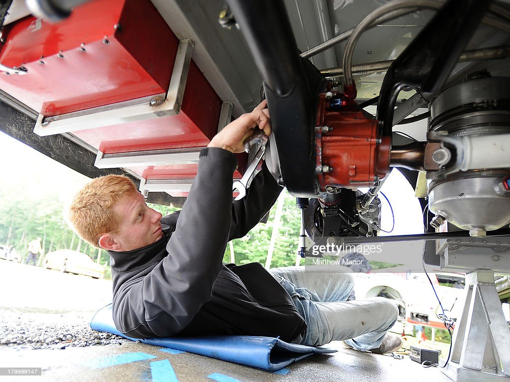 Noel Dowler, driver of the #5 EMCO/Rheem/Praxair Dodge, works under his car prior to the practice session at the NASCAR Canadian Tire Series race at Barrie Speedway on September 7, 2013 in Oro Station, Ontario, Canada.