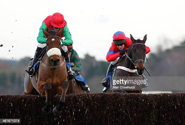 Noel Fehily riding Dodging Bullets cler the last to win The Sodexo Clarence House Steeple Chase from Sprinter Sacre and Barry Geraghty at Ascot...