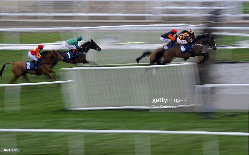 <a gi-track='captionPersonalityLinkClicked' href=/galleries/search?phrase=Noel+Fehily&family=editorial&specificpeople=241420 ng-click='$event.stopPropagation()'>Noel Fehily</a> riding Violin Davis (R) clear the water jump before winning The European Breeders' Fund/Thoroughbred Breeders' Association Mares' Novices' Steeple Chase at Newbury racecourse on January 16, 2013 in Newbury, England.