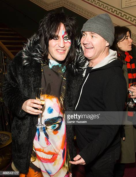 Noel Fielding and Damien Hirst attend a private view of the Noel Fielding art exhibition 'He Wore Dreams Around Unkind Faces' at the Royal Albert...
