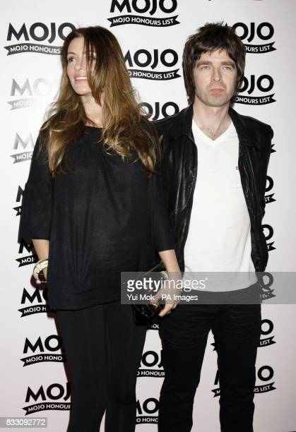 Noel Gallagher and girlfriend Sarah McDonald arrive for the Mojo Honours List award ceremony at The Brewery east London