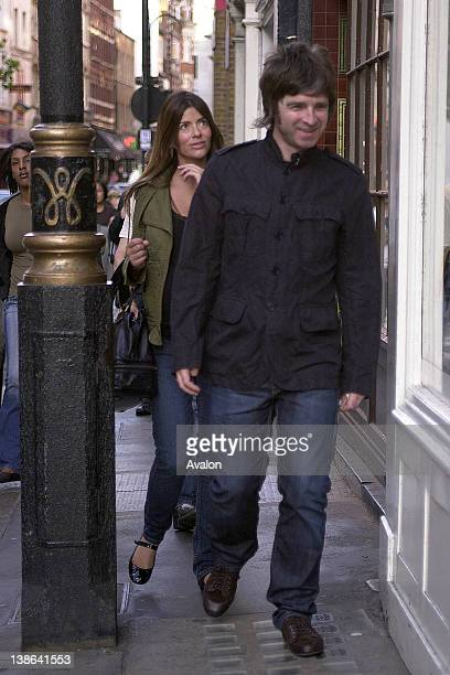Noel Gallagher and his pregnant partner Sara MacDonald walking through Soho London 14th September 2007