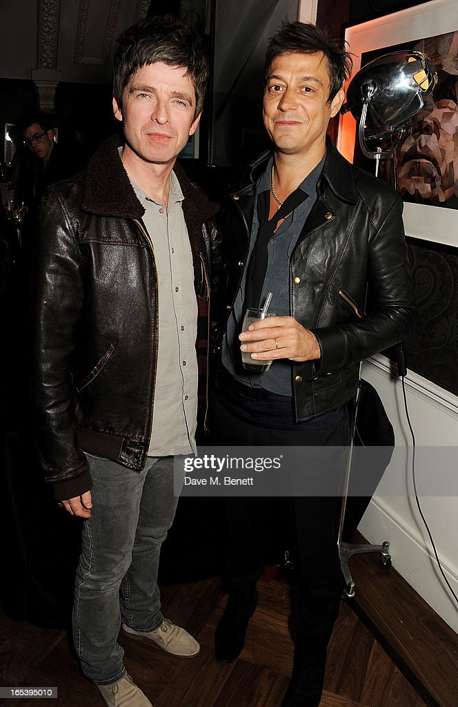 Noel Gallagher (L) and Jamie Hince attend event planner Paul Rowe's 40th birthday party at The Groucho Club on April 3, 2013 in London, England.