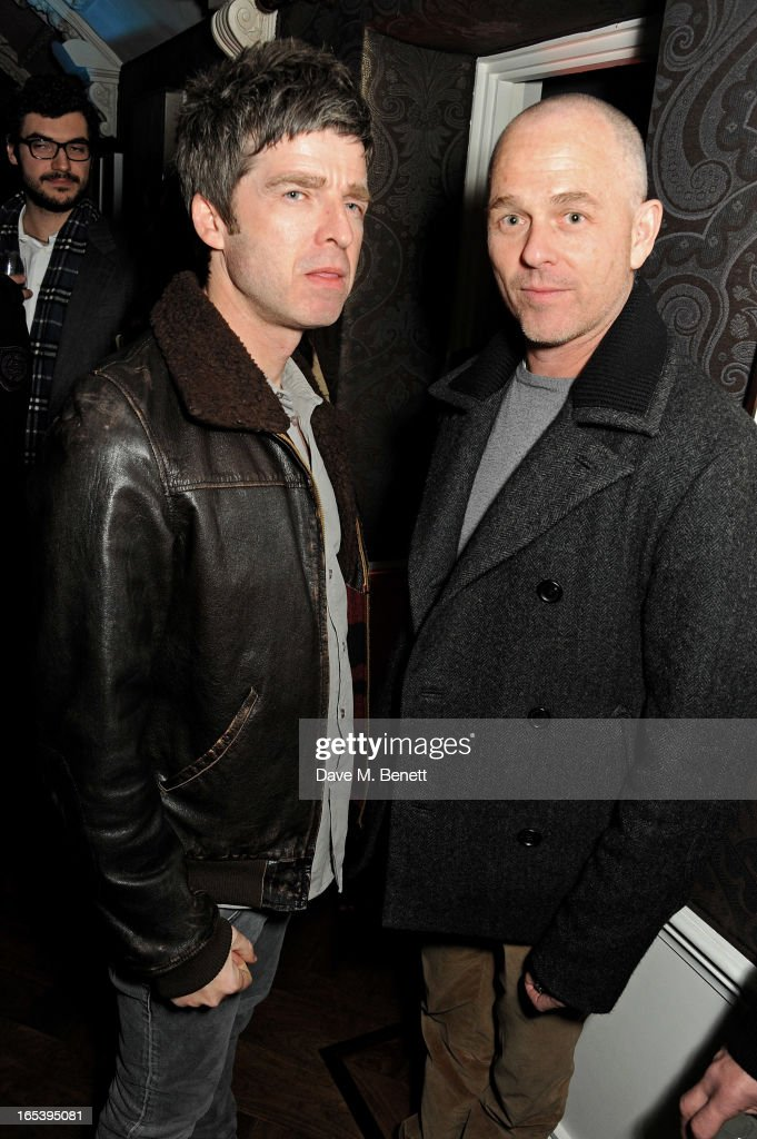 Noel Gallagher (L) and Jan Kennedy attend event planner Paul Rowe's 40th birthday party at The Groucho Club on April 3, 2013 in London, England.