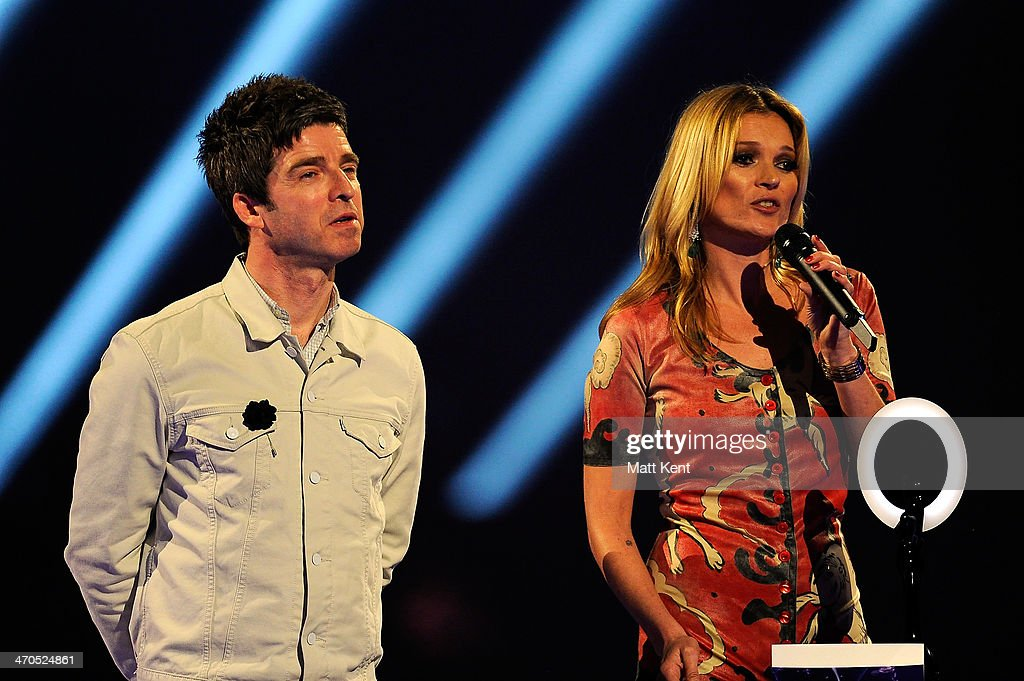 <a gi-track='captionPersonalityLinkClicked' href=/galleries/search?phrase=Noel+Gallagher&family=editorial&specificpeople=209146 ng-click='$event.stopPropagation()'>Noel Gallagher</a> and <a gi-track='captionPersonalityLinkClicked' href=/galleries/search?phrase=Kate+Moss&family=editorial&specificpeople=201830 ng-click='$event.stopPropagation()'>Kate Moss</a> onstage at The BRIT Awards 2014 at 02 Arena on February 19, 2014 in London, England.