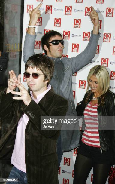 Noel Gallagher and Liam Gallagher of Oasis arrive with Nicole Appleton at The Q Awards the annual magazine's music awards at Grosvenor House on...