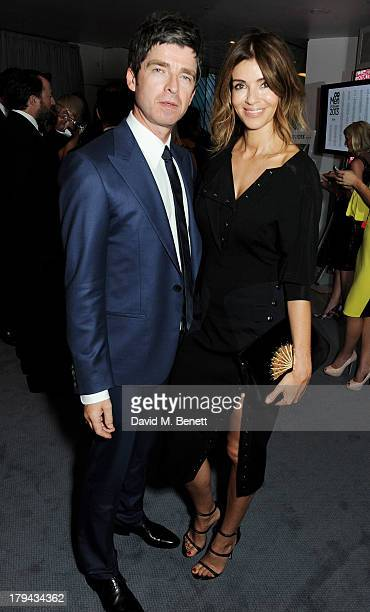 Noel Gallagher and Sara Macdonald arrive at the GQ Men of the Year awards at The Royal Opera House on September 3 2013 in London England