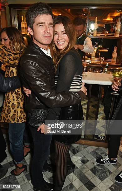 Noel Gallagher and Sara Macdonald attend the adidas Originals by Rita Ora dinner at The Ivy Chelsea Garden on November 23 2016 in London England
