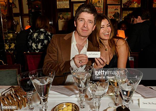 Noel Gallagher and Sara Macdonald attend the launch of Annabel's DocuFilm 'A String of Naked Lightbulbs' at Annabel's on October 28 2014 in London...