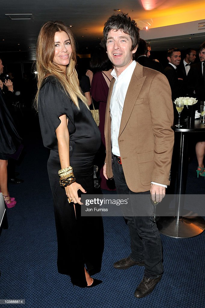 Noel Gallagher and Sarah McDonald arrive for the GQ Men of the Year Awards 2010 at The Royal Opera House on September 7, 2010 in London, England.