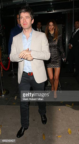 Noel Gallagher and Sarah McDonald at the Playboy club on December 2 2013 in London England