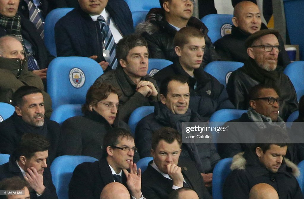 Noel Gallagher, below him Jean Sarkozy attend the UEFA Champions League Round of 16 first leg match between Manchester City FC and AS Monaco at Etihad Stadium on February 21, 2017 in Manchester, United Kingdom.