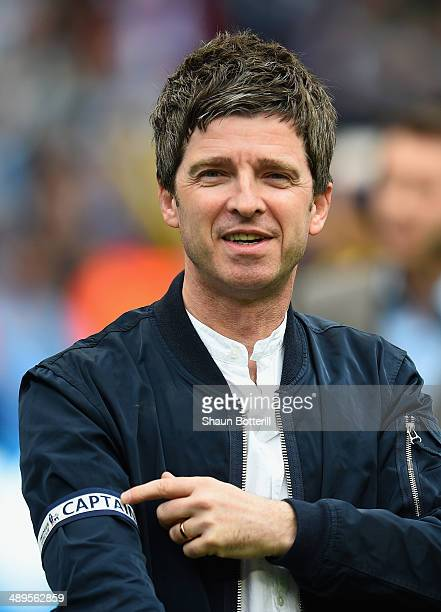 Noel Gallagher celebrates with the Captain's armband at the end of the Barclays Premier League match between Manchester City and West Ham United at...