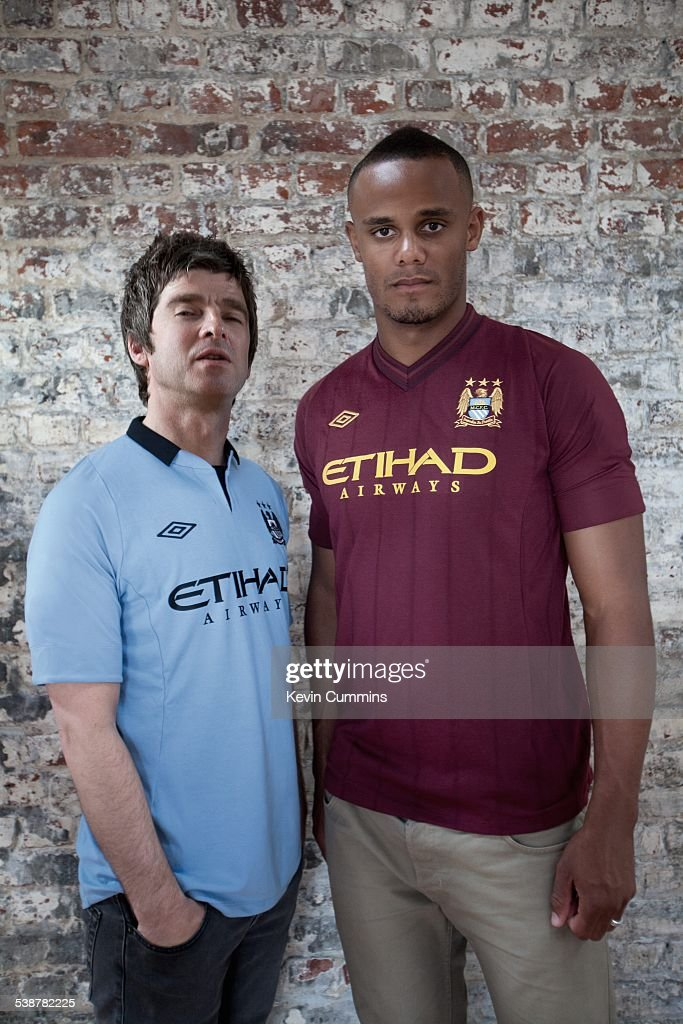 Noel Gallagher (left), of British rock group Oasis, with Belgian footballer and Manchester City captain Vincent Kompany, 2nd July 2012.