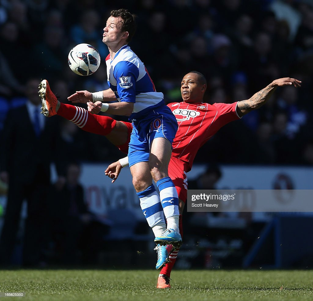 Noel Hunt of Reading and <a gi-track='captionPersonalityLinkClicked' href=/galleries/search?phrase=Nathaniel+Clyne+-+Soccer+Player&family=editorial&specificpeople=5738873 ng-click='$event.stopPropagation()'>Nathaniel Clyne</a> of Southamptonbattle for the ball during the Barclays Premier League match between Reading and Southampton at the Madejski Stadium on April 6, 2013 in Reading, England.