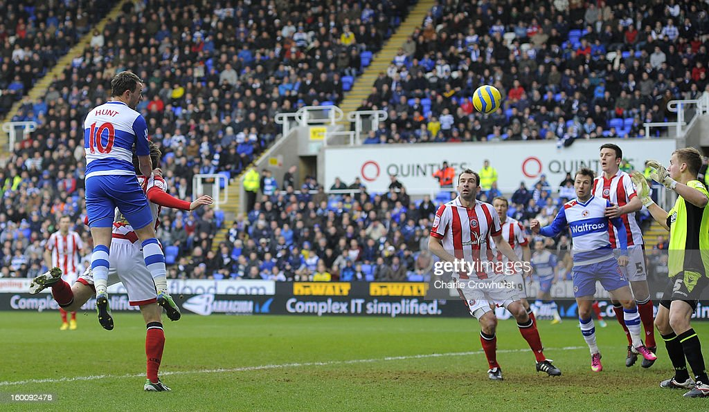 Noel Hunt of Reading scores the first goal of the game during the FA Cup Fourth Round match between Reading and Sheffield United at the Madejski Stadium on January 26, 2013 in London England.