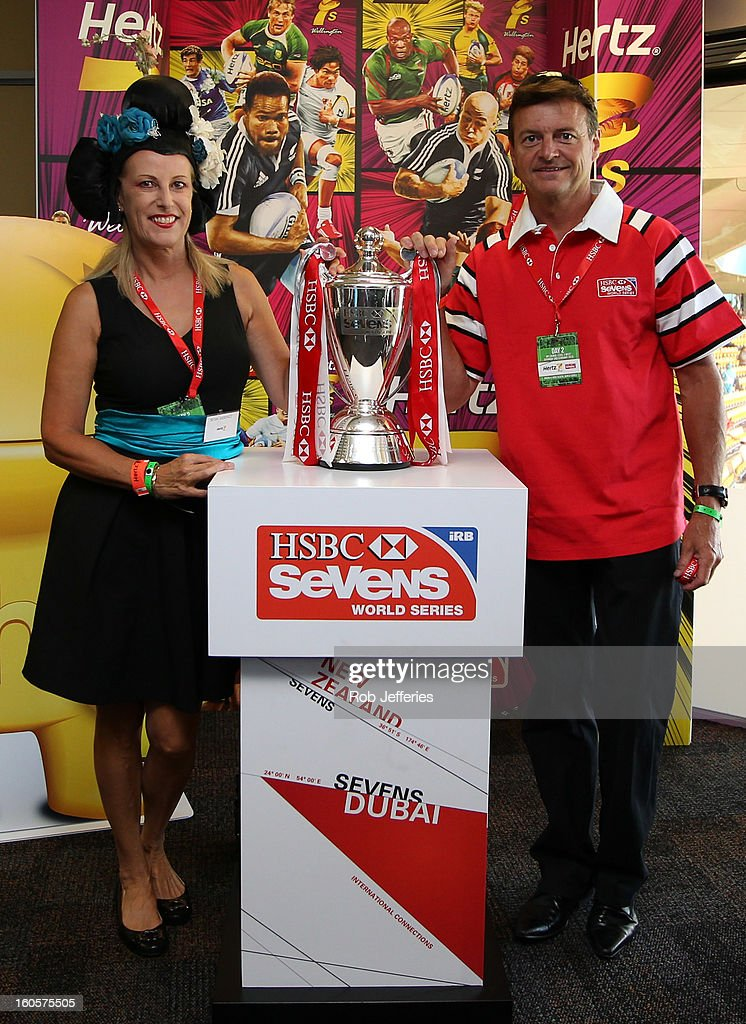 Noel McNamara, CEO HSBC New Zealand and his partner pose for a photo during the Hertz Sevens, Round four of the HSBC Sevens World Series Westpac Stadium on February 2, 2013 in Wellington, New Zealand.