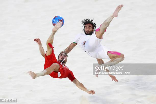 Noel Ott of Switzerland attempts a scissor or bicycle kick shot on goal in front of Amir Akbari of Iran during the FIFA Beach Soccer World Cup...