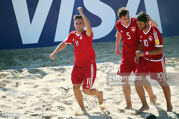 Noel Ott of Switzerland celebrates his team's second goal with team mates Michael Misev and Philipp Borer during the FIFA Beach Soccer World Cup...