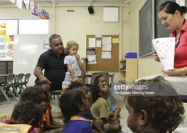 Noel Pearson Director of the Cape York Institute is photographed with his son Charlie and students at the Aurukun campus of the Cape York Australian...