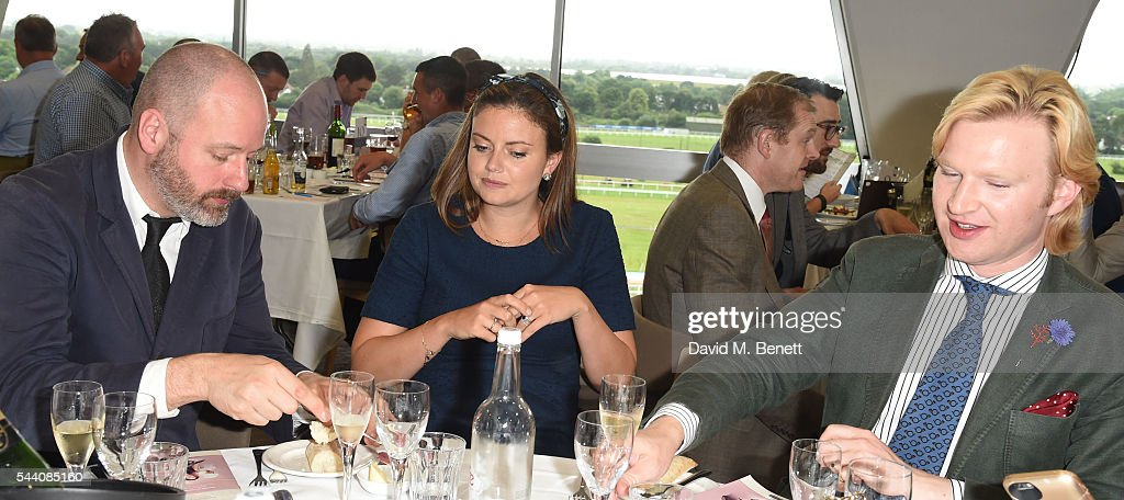 Noel Stewart, Lady Natasha Rufus Isaacs and Henry Conway attend the Sandown Park Racecourse Ladies' Day STYLE AWARD Hosted by Rosie Fortescue at Sandown Park on July 1, 2016 in Esher, England.
