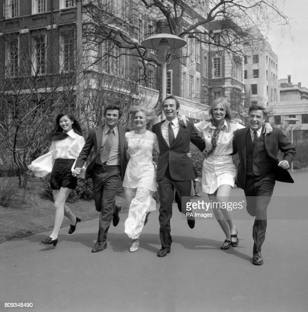 Noelle Kao Peter Falk Jenny LeeWright Ben Gazzara Jenny Runacre and John Cassavetes running through the Embankment Gardens London They all star in...