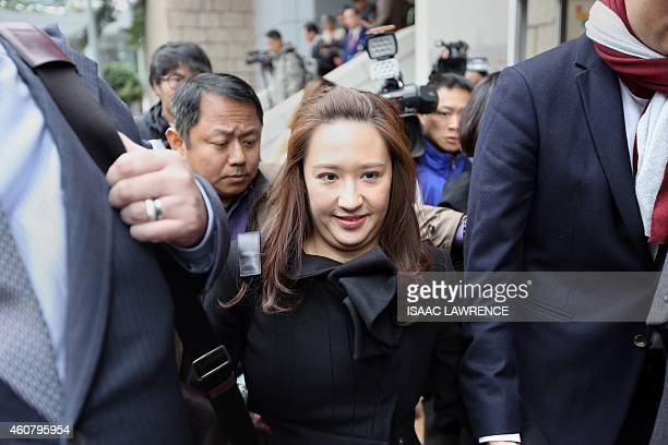Noelle Kwok daughter of Sun Hung Kai Properties cochairman Thomas Kwok leaves the court after her father was sentenced to five years jail on...