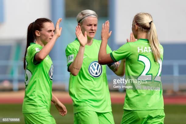 Noelle Maritz Nilla Fischer and Pemille Harder of Wolfsburg celebrate a goal during the Women's Friendly Match between VfL Wolfsburg Women's and...