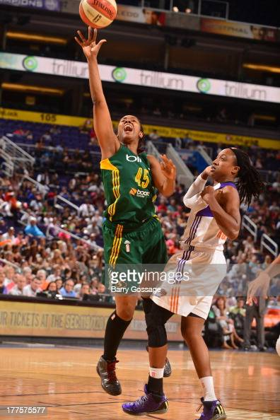 Noelle Quinn of the Seattle Storm shoots against Alexis Hornbuckle of the Phoenix Mercury on August 23 2013 at US Airways Center in Phoenix Arizona...