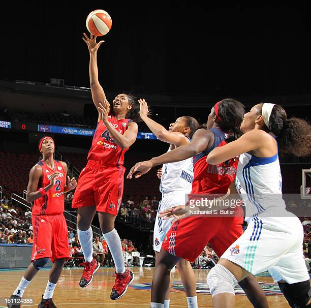 Noelle Quinn of the Washington Mystics shoots against Kia Vaughn of the New York Liberty during a game on September 1 2012 at the Prudential Center...