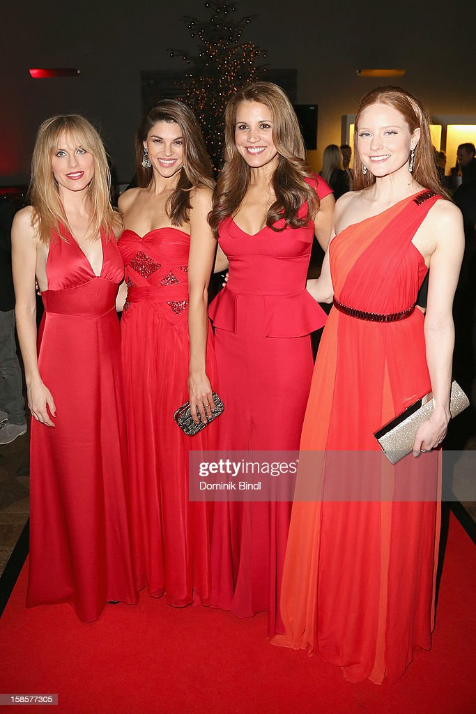 Noemi Matsutani,Viola Mazza, Karen Webb and <a gi-track='captionPersonalityLinkClicked' href=/galleries/search?phrase=Barbara+Meier&family=editorial&specificpeople=4304499 ng-click='$event.stopPropagation()'>Barbara Meier</a> attend the Natascha & Gernot Gruen 'Golden Red Christmas Night' Party on December 19, 2012 in Munich, Germany.