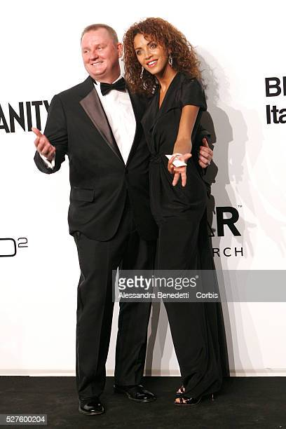 Noemie Lenoir and Amfar Ceo Kevin Robert Frost on the AmfAR Milano 2009 red carpet during the inaugural Milan Fashion Week event at La Permanente