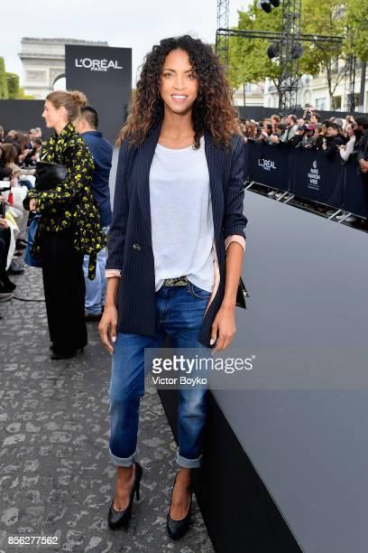 Noemie Lenoir attends Le Defile L'Oreal Paris as part of Paris Fashion Week Womenswear Spring/Summer 2018 at Avenue Des Champs Elysees on October 1...
