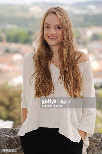 Noemie Schmidt poses at a photocall for the film 'L'etudiante et Monsieur Henri' during the 8th Angouleme FrenchSpeaking Film Festival on August 27...