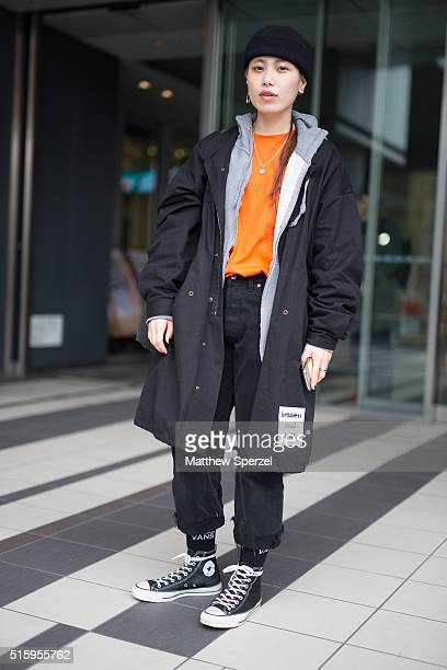 Noeno attends the Anne Sofie Madsen show during Tokyo Fashion Week wearing Of hoodie MYOB shirt and coat and Converse shoeson March 16 2016 in Tokyo...