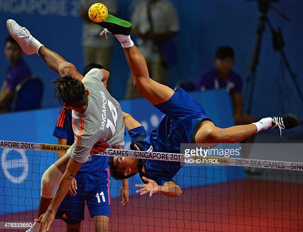 Nofrisal Nofrisal of Indonesia jumps for the ball against Singapore's Muhammad A'Fif Safiee during the men's team sepaktakraw preliminary round match...