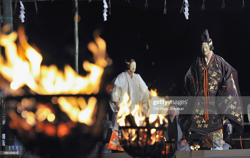 Noh, Japanese traditional dance is performed at Heian Jingu Shrine on June 1, 2014 in Kyoto, Japan. The event is held to celebrate the birth of Noh actors Kan'ami and Zeami last year, 680th and 650th respectively.