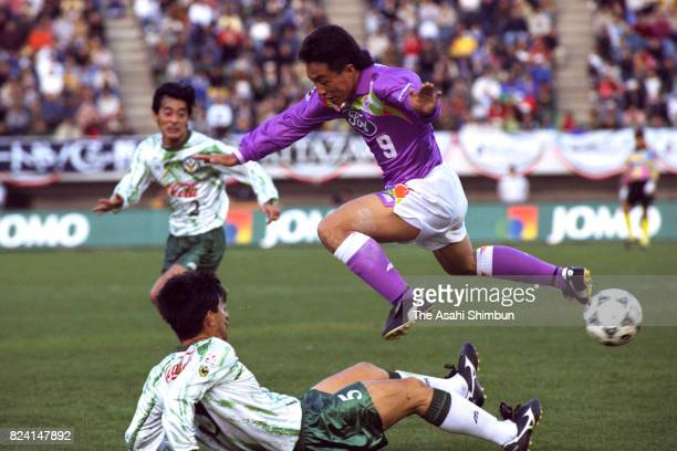 Noh Jungyoon of Sanfrecce Hiroshima is tackled by Hisashi Kato of Verdy Kawasaki during the JLeague Championship first leg match between Sanfrecce...