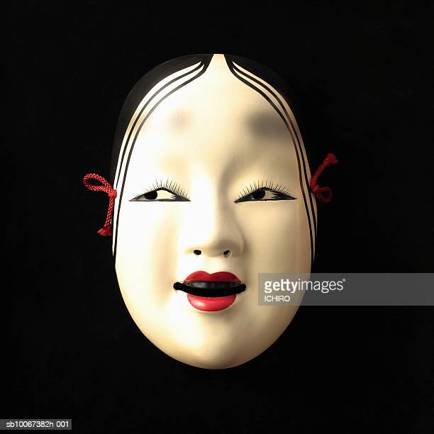 Noh mask on black background